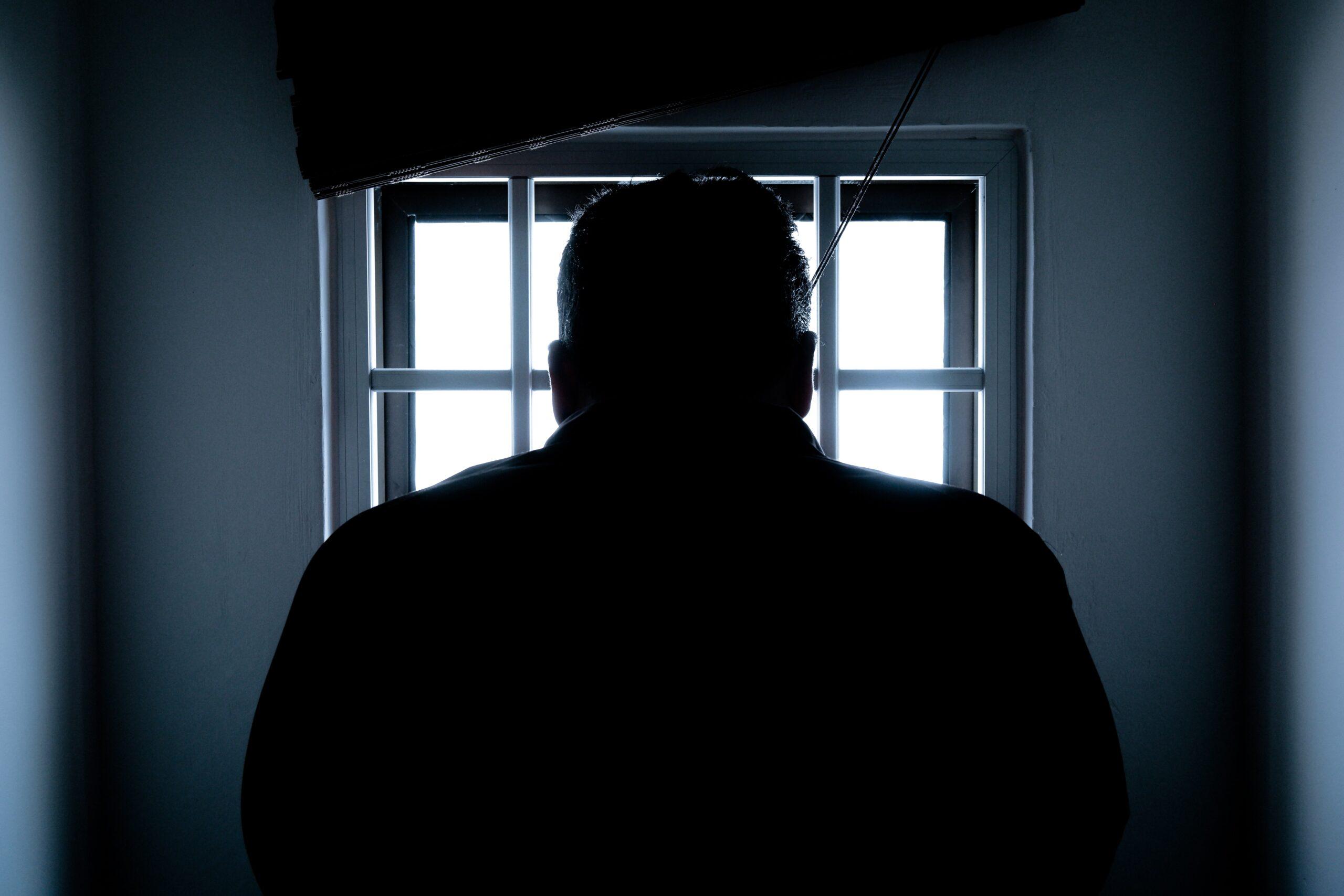 silhouette-of-a-man-in-window-143580