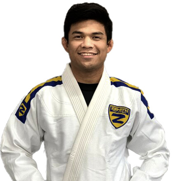 a photo of sonny sebastian staring into the camera with his arms on his belt