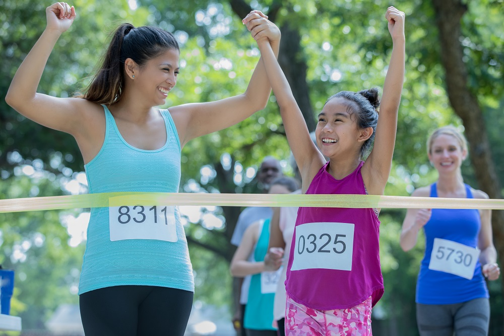 Mother urging child to complete race is an example of the competitiveness of parental peer pressure and c