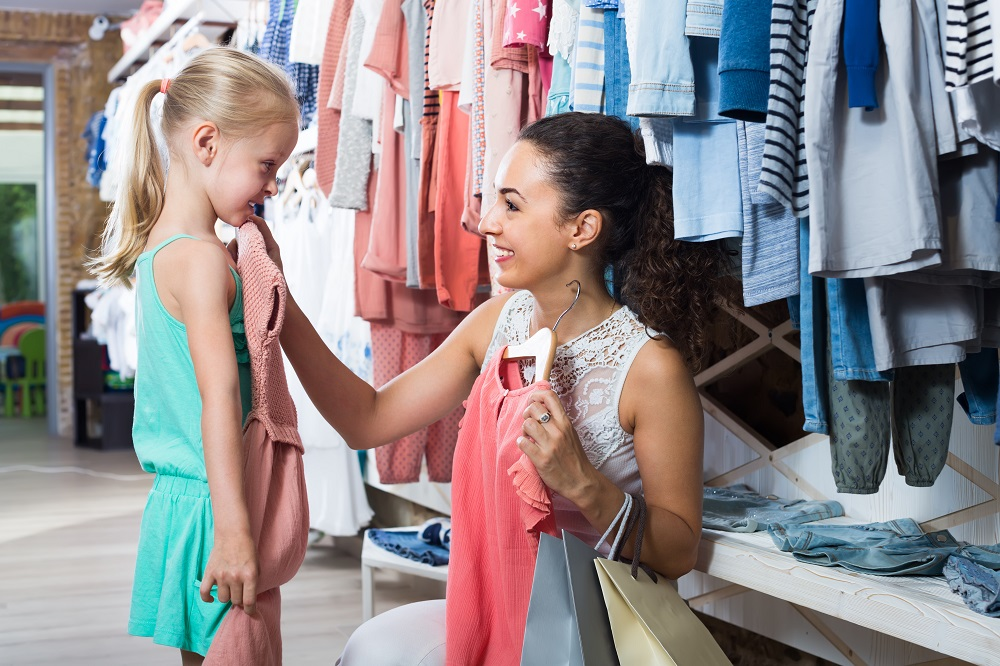 Mom and daughter school shopping together