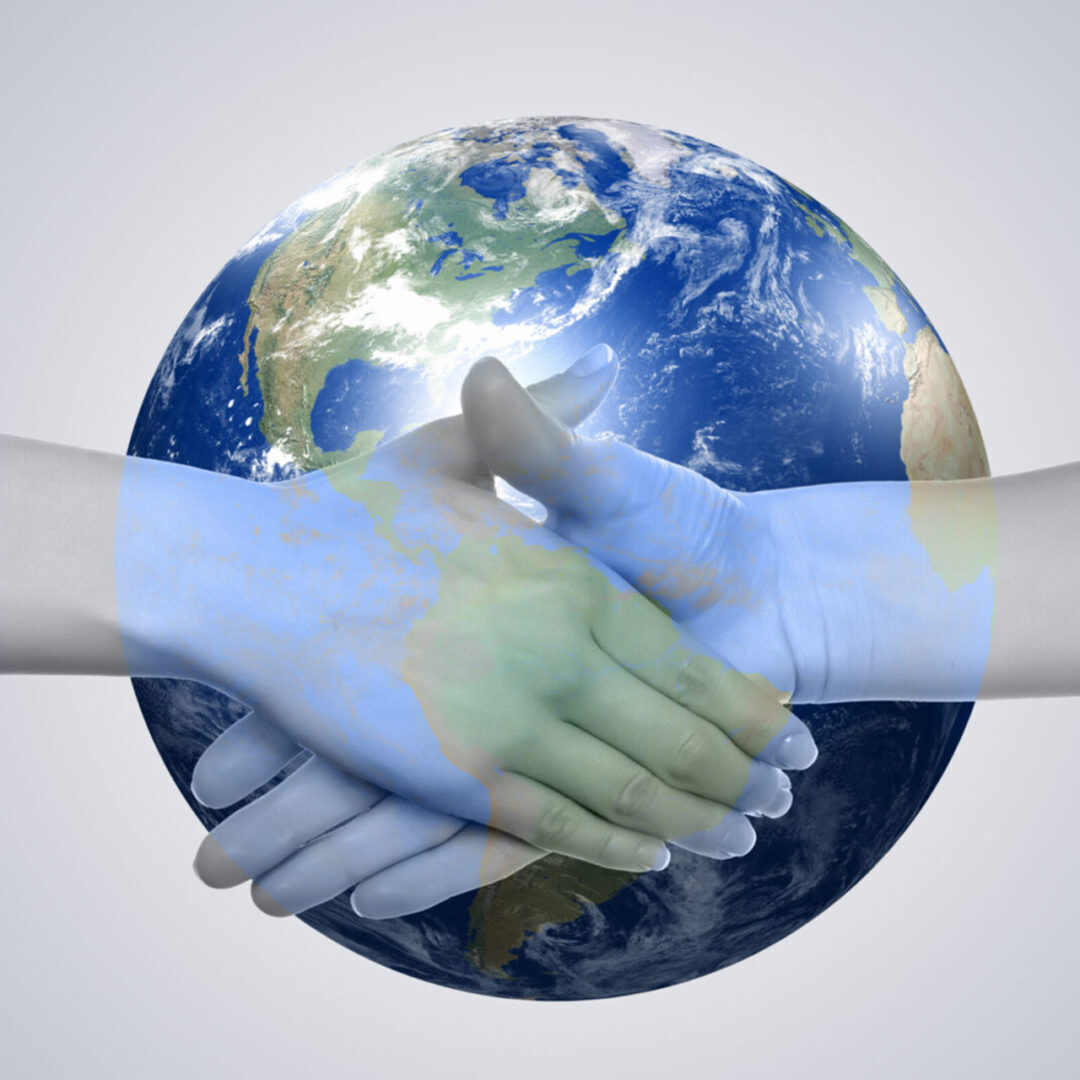 Shaking-hands-w_-globe-scaled