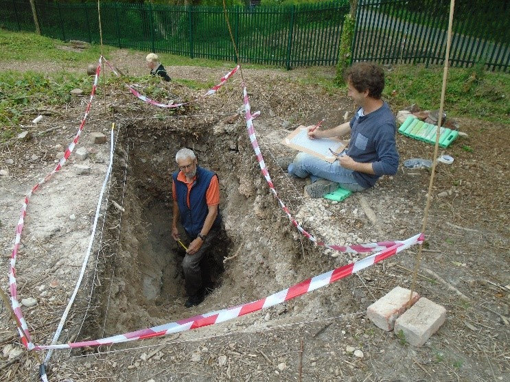 Volunteers excavate the inside of the kiln pot of the first bottle kiln