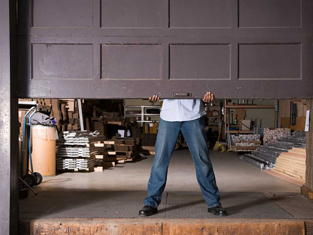 When do garage door repairs require professional help?