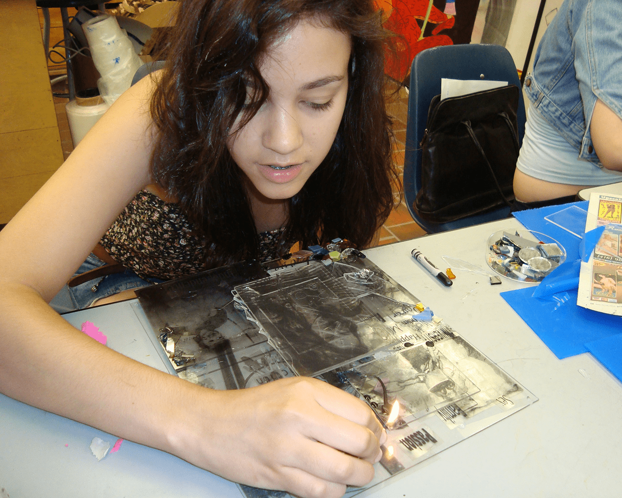 Student working on art piece