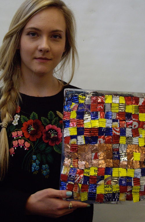 Student with her artwork