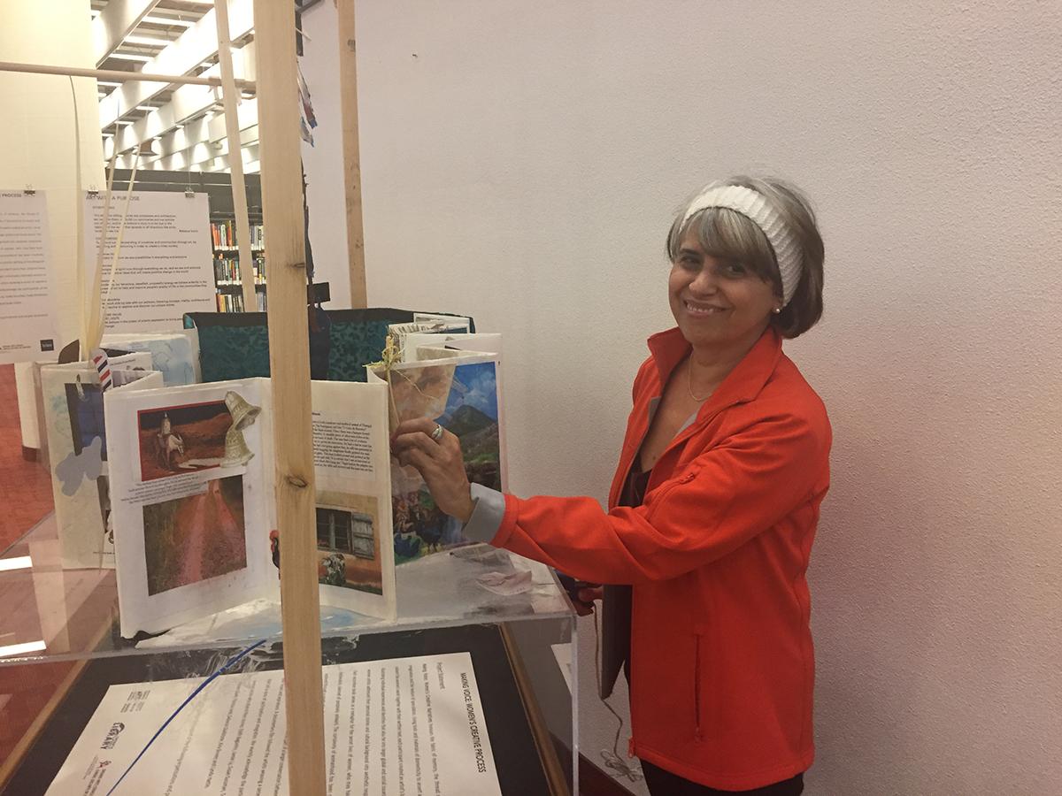 Woman displaying artwork