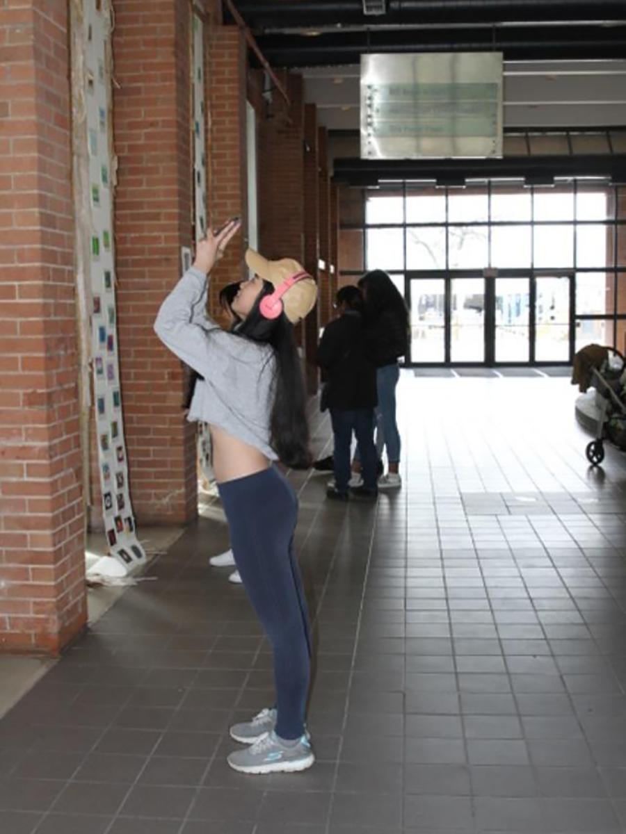 Student at Art Exhibit
