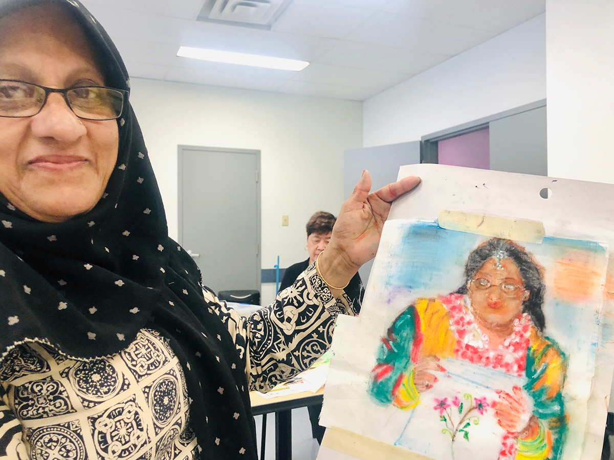 Student showing artwork