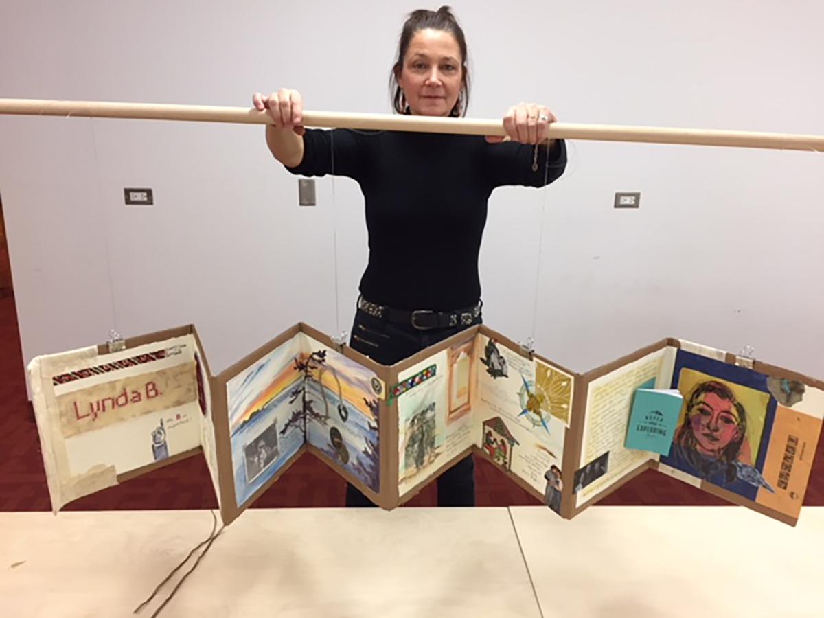 Woman displaying her artwork
