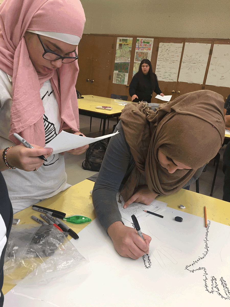 Students working on art piece