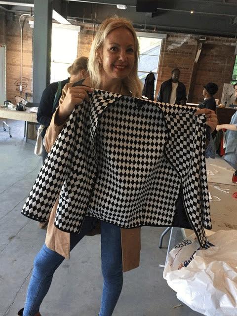 Woman holding jacket