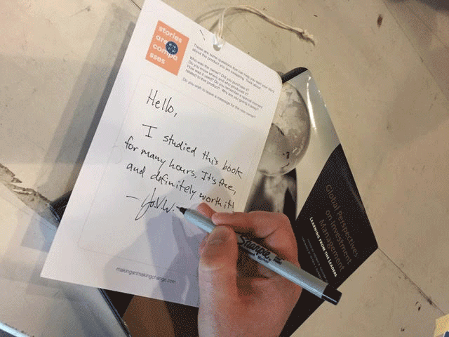 Someone writing a note