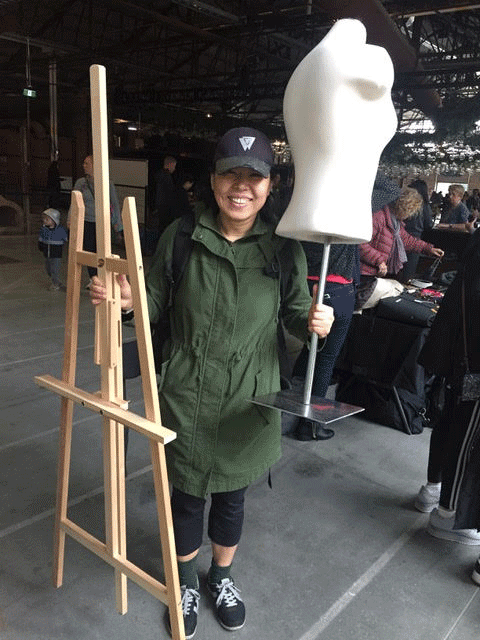 Woman holding mannequin
