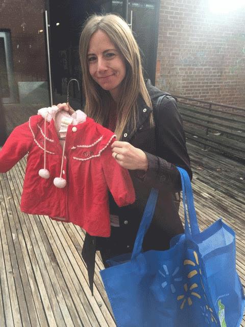 Woman holding child's jacket