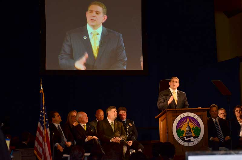 """Mayor Virg Bernero delivers message during his State of the City (SOC) address at the Lansing Board of Water & Light's (BWL) train depot in """"REO Town"""". Future Media Corporation provided teleprompting, event lighting and audio services."""