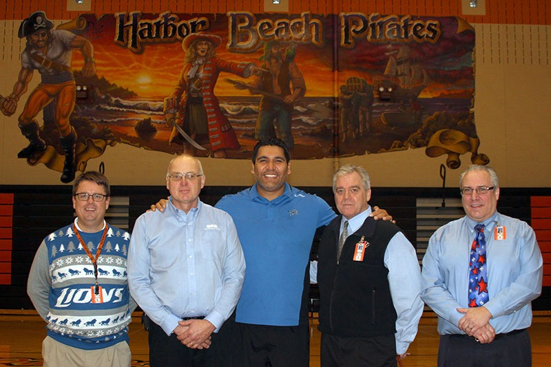 Future Media Corporation documents former Detroit Lions defensive tackle Luther Elliss poses with school administrators following a general assembly at Harbor Beach Community Schools. Sponsored by the United Dairy Industry of Michigan.