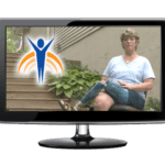 "Video monitor with Springer Prosthetics ""Bio"" image, woman with prosthetic leg sitting in chair outdoors in back yard."