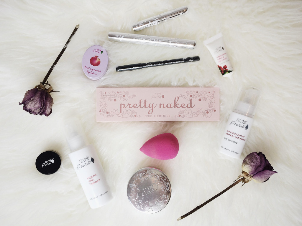 100 percent pure makeup items on white fur rug
