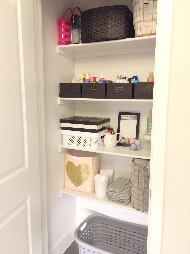 Inside of the bathroom and linen closet