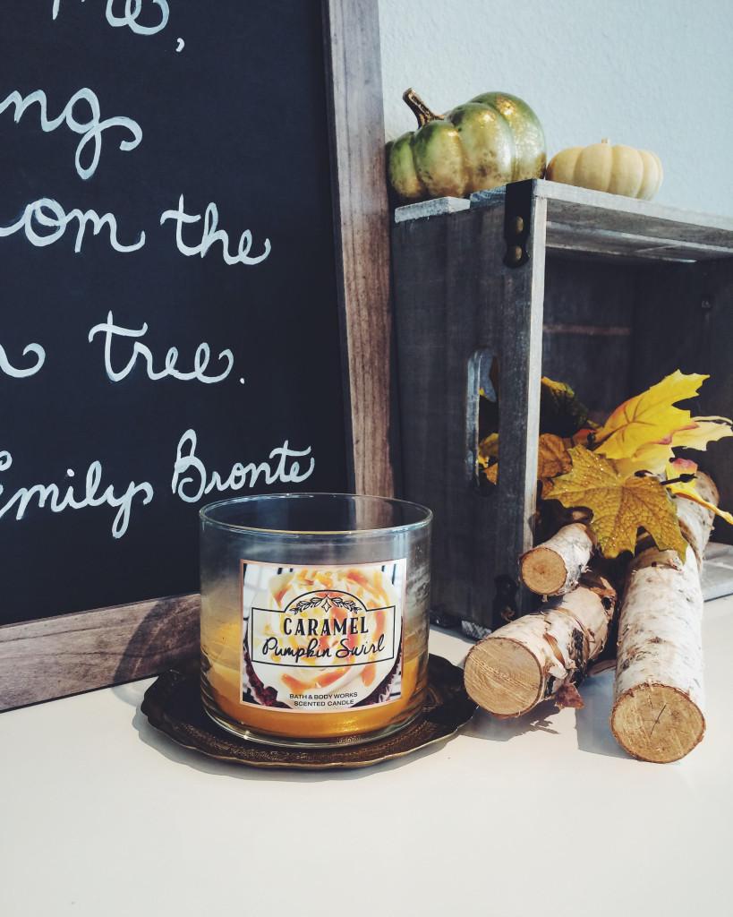 Caramel pumpkin swirl bath and body works candle on gold tray