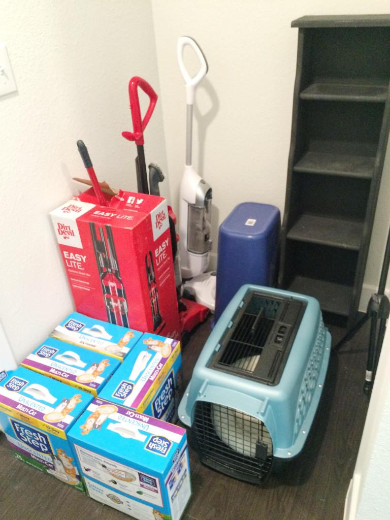 Before shot of clutter in hallway nook