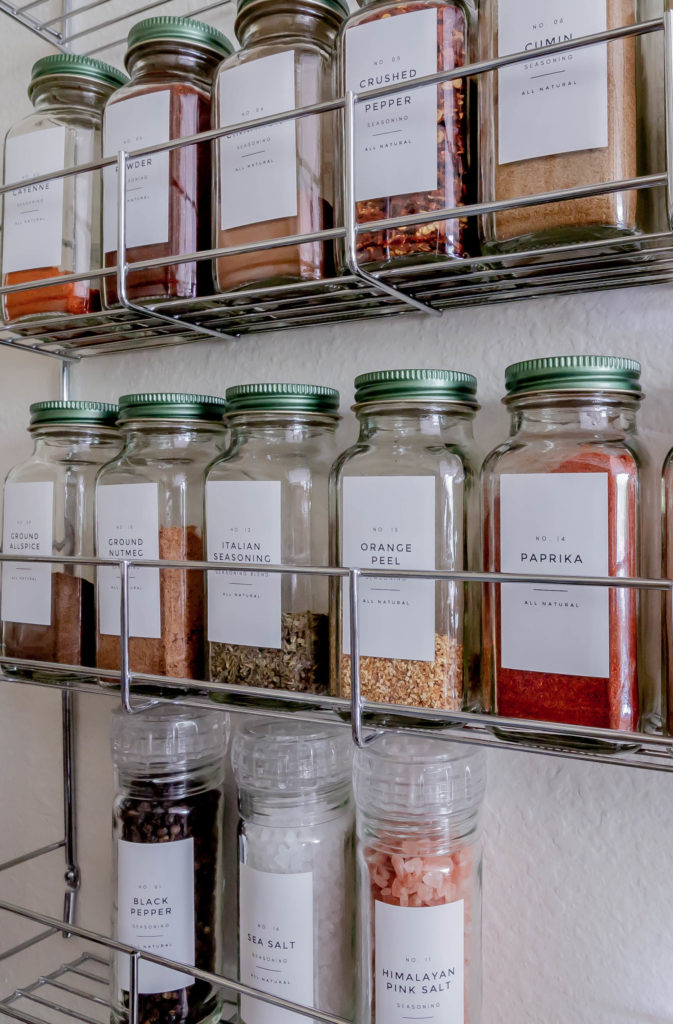spice jars on rack on wall