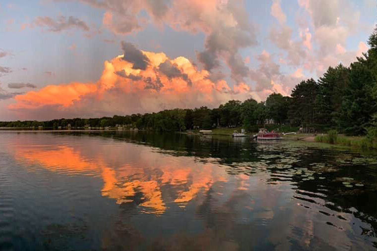 Orange clouds reflected on lake