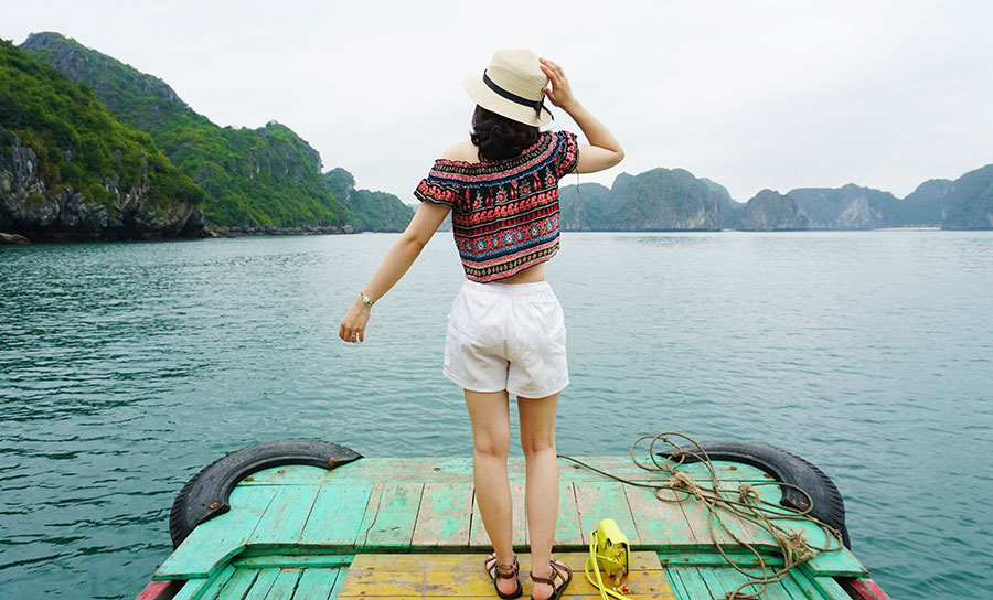 A woman stands looking across Lan Ha Bay. Photo: Supplied