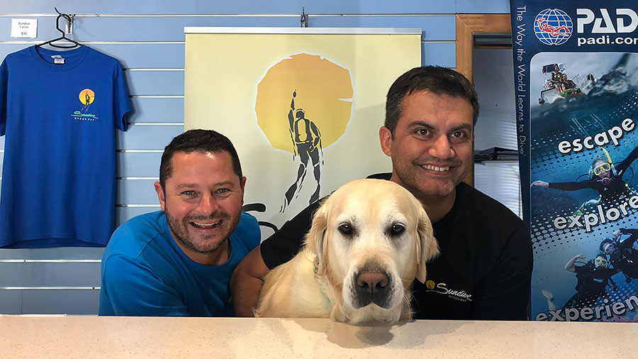 David Robinson (L) and Simone Caprodossi (R), with shop assistant Abby. Credit: Supplied