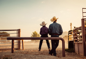 Man and son with cowboy hats