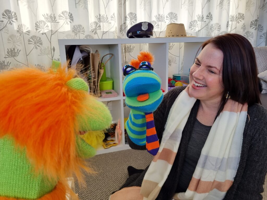 Marie playing with puppets