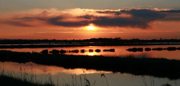 italiainpiega-pieghe-meraviglise-itinerari-moto-pianura-padana-delta del po-tramonto