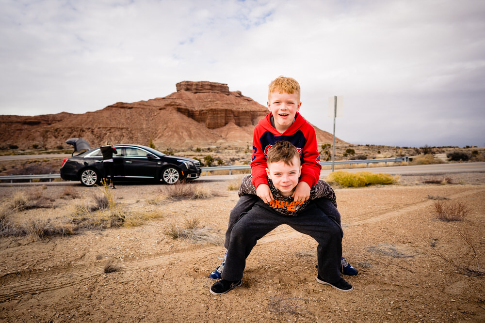 Planning your epic Utah family vacation. Two brothers play in the dirt in Moab Utah