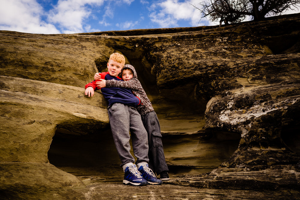 Planning your epic Utah family vacation. Two brothers play in Utah caves