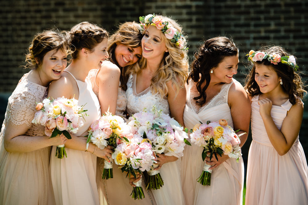 BHLDN bride and bridesmaids hugging in Columbus, Ohio