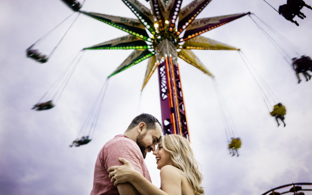 Bride and Groom hugging and smiling at the Yoyo ride during the Ohio State Fair