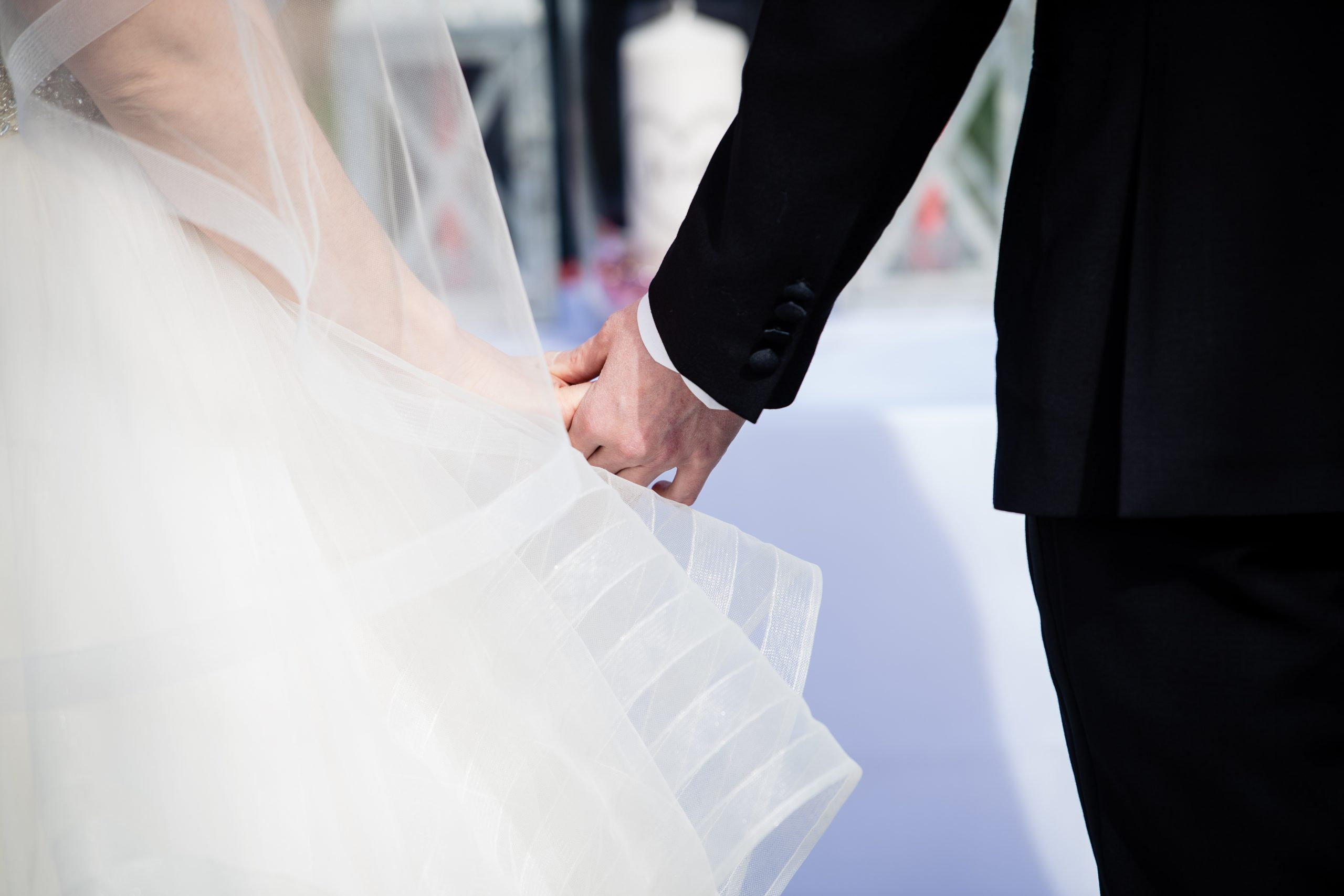 Bride and Groom hold hands during their COVID ceremony in Columbus, Ohio