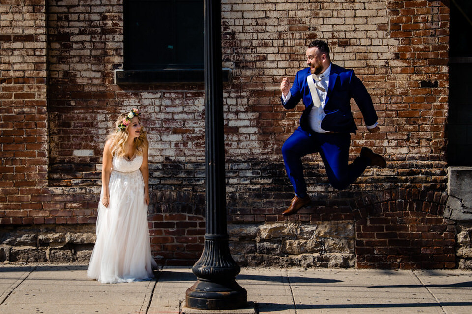 Groom jumping over his bride in Downtown Columbus on his wedding day