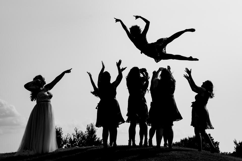 Bridesmaids throw another bridesmaids in the air in Columbus, Ohio