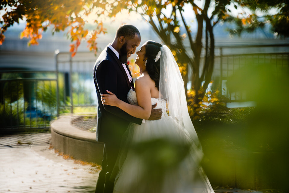 Bride and Groom share a moment in Louisville KY at Muhammed Ali Museum