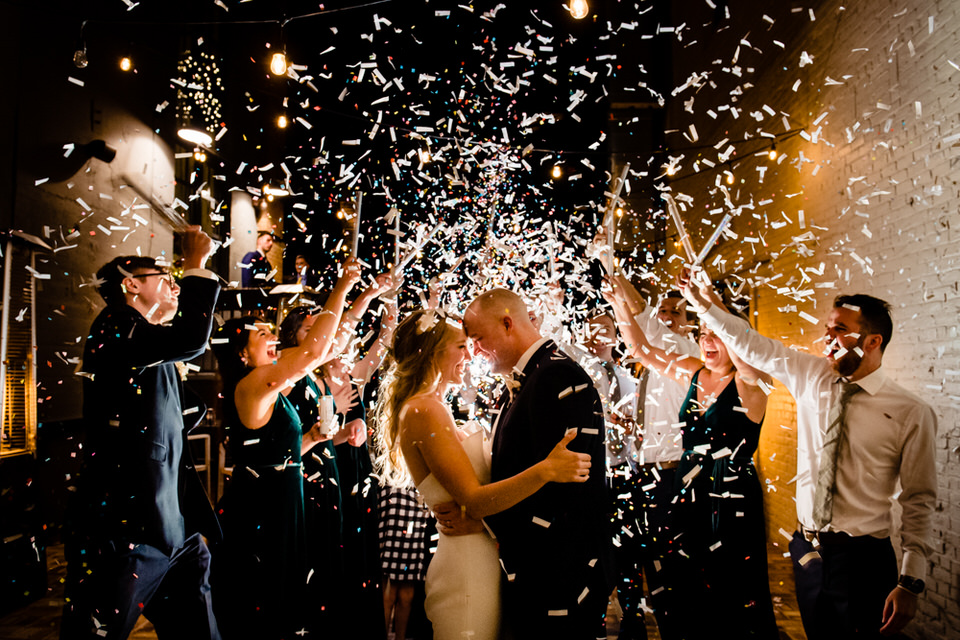Bridal Party throw confetti on bride and groom at the Steam Plant in Dayton, Ohio