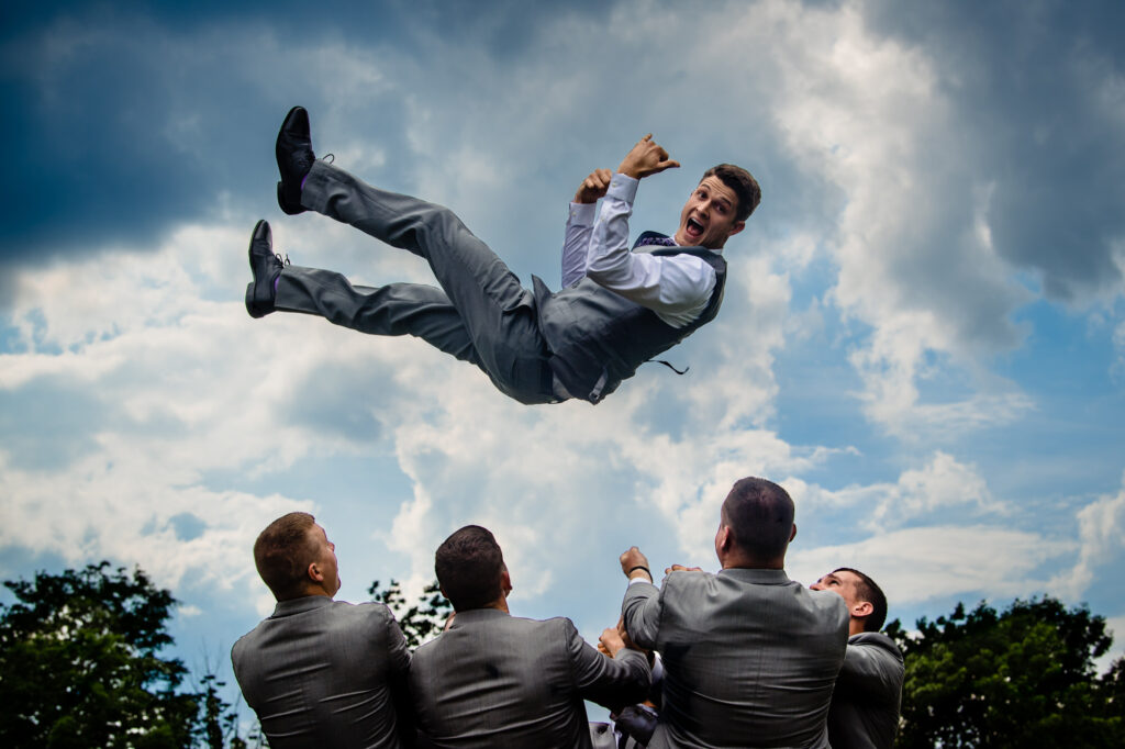 jumping groom at Grove City Wedding Venue