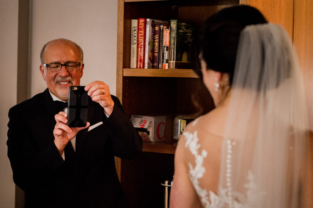 proud father taking picture of bride for Columbus Ohio Westin Wedding