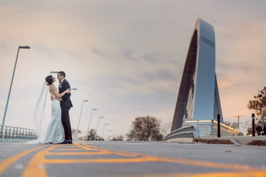 bride and groom on a bridge