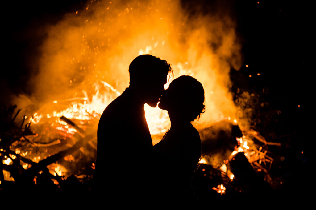 Fire behind kissing couple