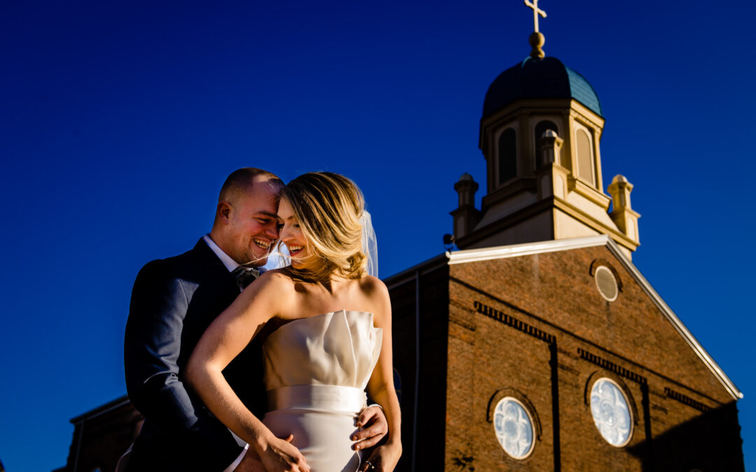 A bride and groom taking a picture at The University of Dayton