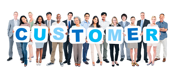 A group of People holding letters that spell Customer