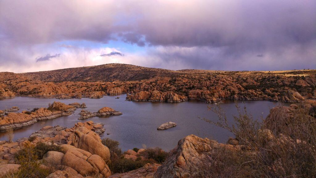 View of Watson Lake in Prescott, Arizona. You can see the granite coloring of the rock formations in the lake.
