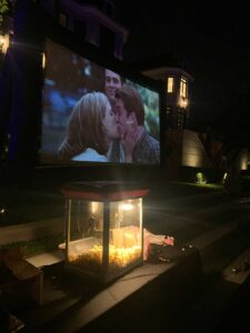 Backyard Movie Screening at night with popcorn machine