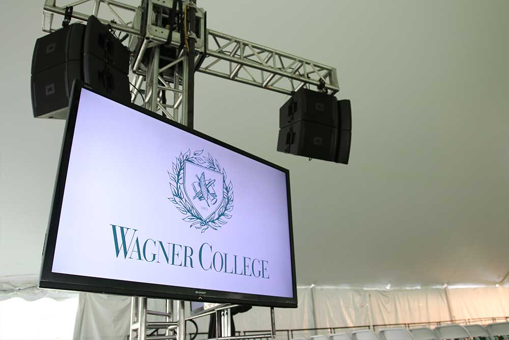 Outdoor Graduation And Commencement Ceremonies with School logo on screen